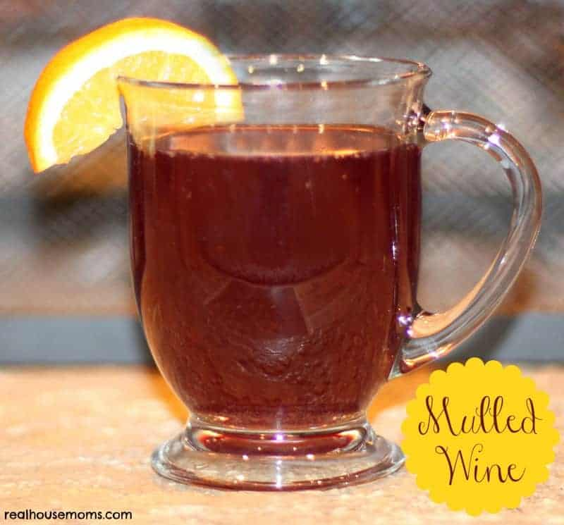 mulled wine in clear mug with citrus slice