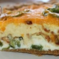 slice of bacon jalapeno popper quiche on a white plate