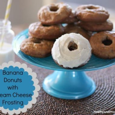 banana donuts with cream cheese frosting on a blue cakestand