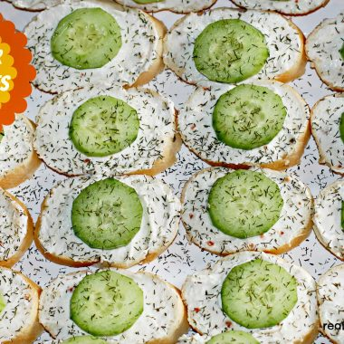 open faced cucumber sandwiches on a platter