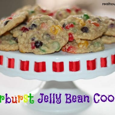 starburst jelly bean cookies on a white cake plate with red trim