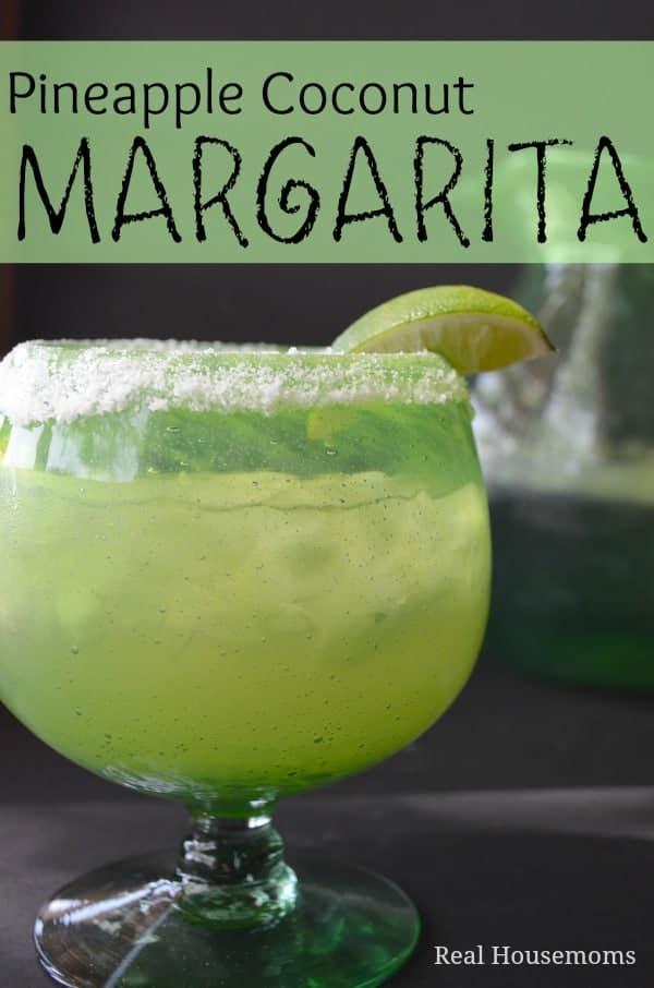 pineapple coconut margarita in a glass with salted rim and lime garnish