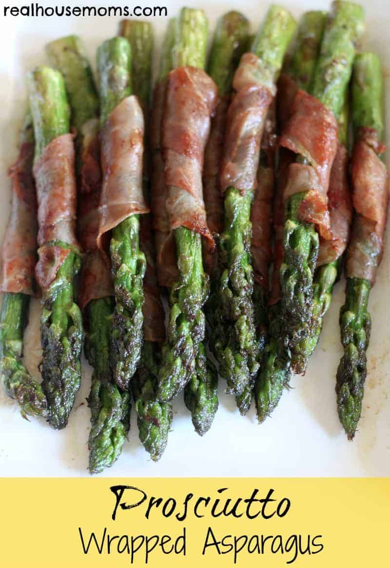 prosciutto wrapped asparagus on a plate