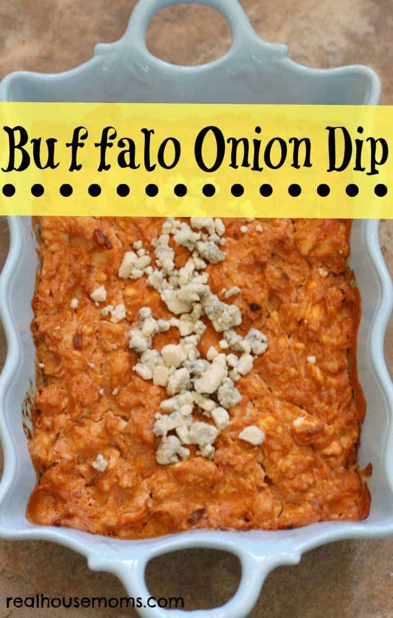 buffalo onion dip topped with crumbled cheese in a white serving bowl