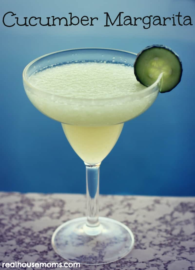 cucumber margarita in a margarita glass and garnished with a cucumber