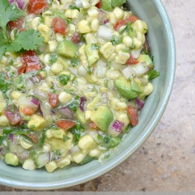 southwest corn salsa in a bowl with cilantro garnish