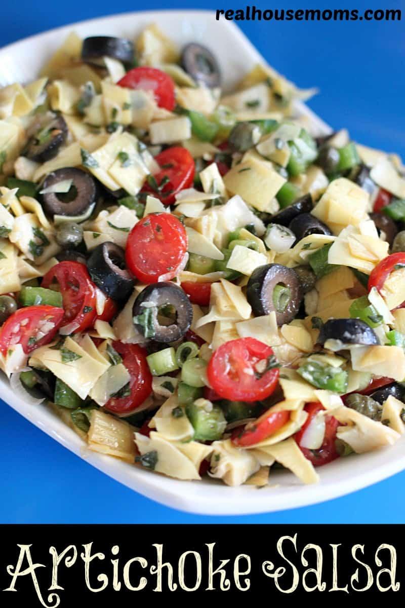 artichoke salsa in a white serving dish