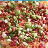 layered bacon ranch dip on a plate