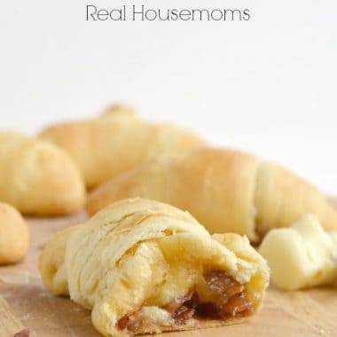 brown sugar, bacon & brie crescent rolls on a wooden board