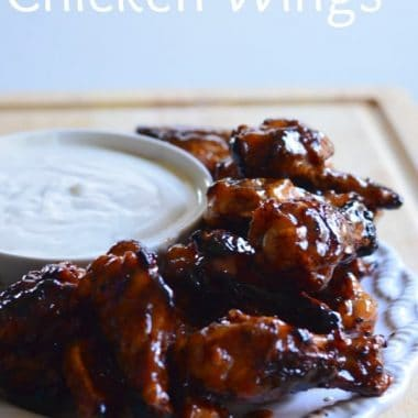 honey bbq chicken wings on a plate with dip