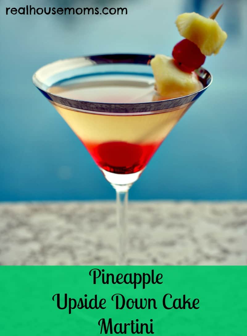 pineapple upside down cake martini in martini glass and fruit garnish