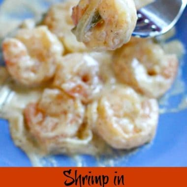 shrimp in jalapeno cream sauce on a blue plate