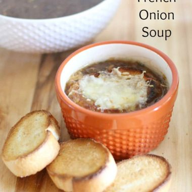 french onion soup in a ramekin with sliced baguette