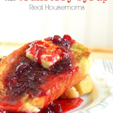 orange french toast with cranberry syrup on a plate