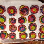 rainbow sprinkle shortbread melt away cookies on a baking sheet