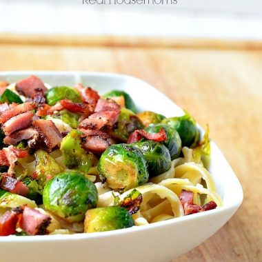 fettucini caulifredo with brussels sprouts and bacon in a bowl