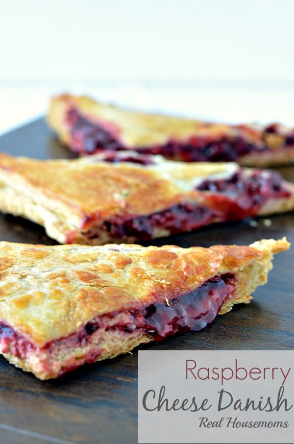 This super easy Raspberry Cheese Danish recipe is so delicious, you'll want to make them all the time!! This breakfast pastry will rival any bakery!