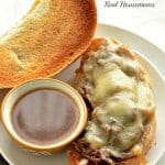 slow cooker french dip sandwich served with au jus