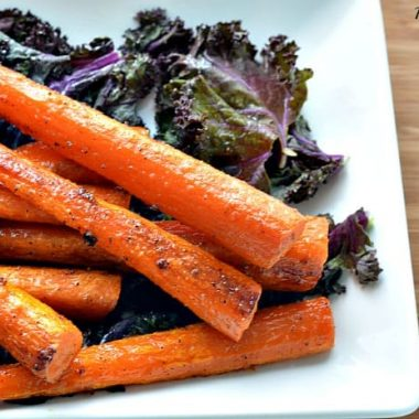 honey roasted carrots with garnish on a white plate