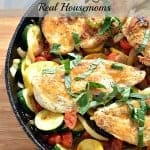 one pan chicken and vegetables in a cast iron skillet