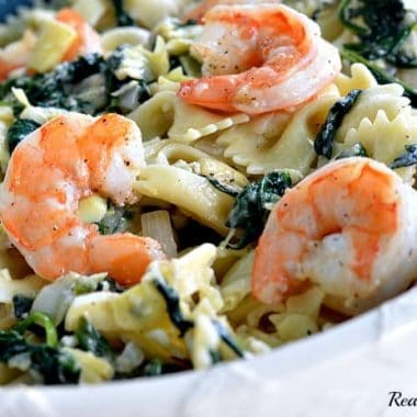 garlic roasted shrimp atop spinach artichoke pasta