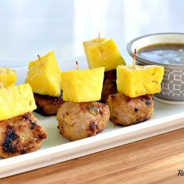 pineapple teriyaki turkey meatballs topped with pineapple on a serving platter