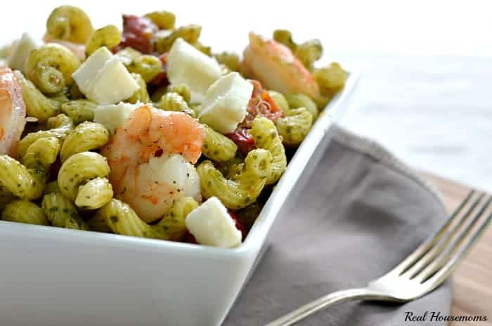 quick pesto and shrimp pasta in a bowl with a fork and napkin