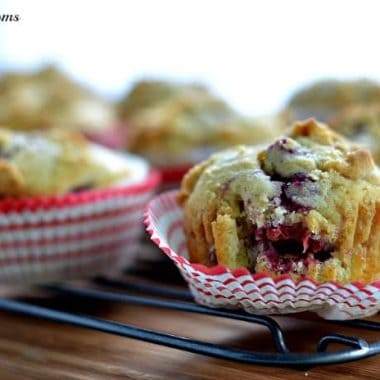 raspberry muffins on a baking rack