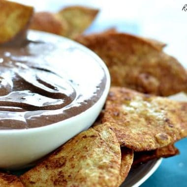 mexican chocolate cannoli dip in a bowl served with cinnamon sugar chips