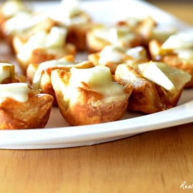 Pear Caramelized Onion and Brie Bites arranged on a platter