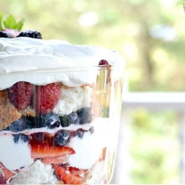 close up of Berries and Cream Angel Food Trifle displayed in a parfait glass