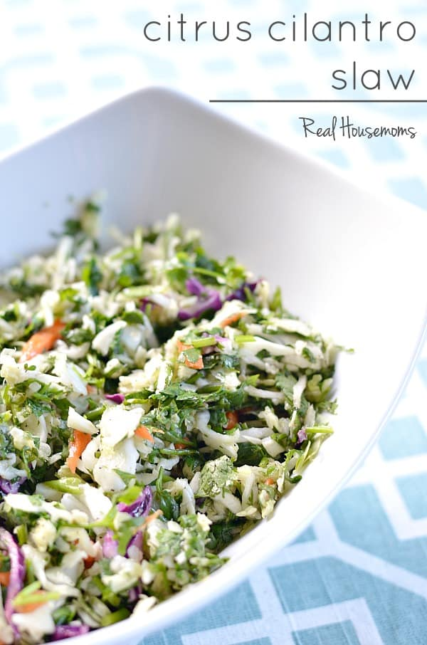 Citrus cilantro slaw in a white bowl
