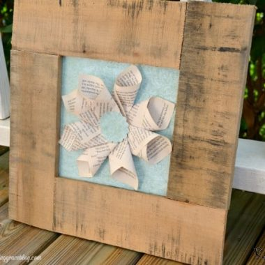 Pallet book page art Frame made from wood with book pages folded like a flower in the middle of frame