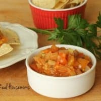 Homemade Garden Salsa with i side of chips displayed in a small white sharing bowl