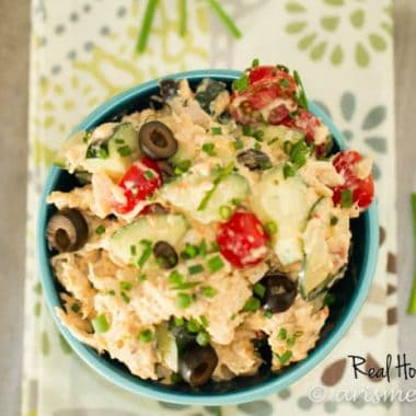 Hummus Chicken Salad displayed in a blue bowl topped with black olives