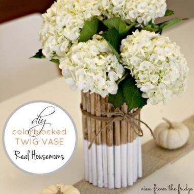 DIY Twig Vase with white flowers in vase