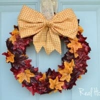 Fall Wreath leaves added to wreath with cute bow at the top
