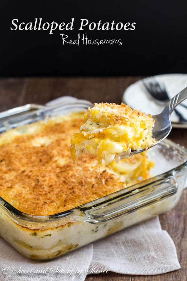 Baking dish with scalloped potatoes and a serving spoon taking a scoop