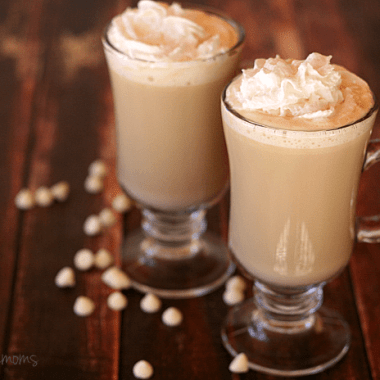 Rich and creamy, white chocalate mocha latte topped with whip cream served in two cold coffee glasses