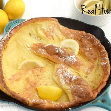 Dutch Baby Recipe topped with lemon served in a skillet