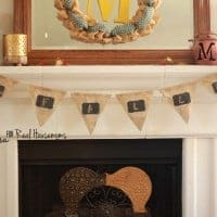 Chalkboard welcome banner made of burlap with gold detailing and mini chalkboard