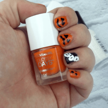 Halloween Nail Art Tutorial photo of halloween nails holding Orange nail polish