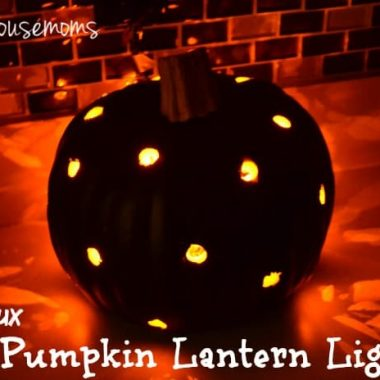 Pumpkin Lantern Light black pumpkin with drill holes to let light escape