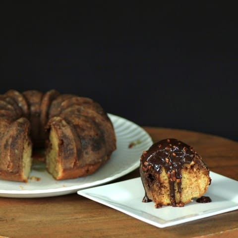 SNICKERS BUNDT WITH CHOCOLATE CARAMEL PEANUT SAUCE