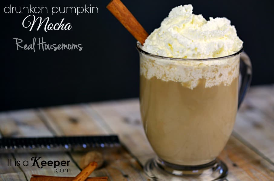 Drunken Pumpkin Mocha topped with whip cream garnished with a cinnamon stix
