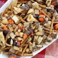 Fall Chex Mix, chex mix with added candy corn seved in a white baking dish