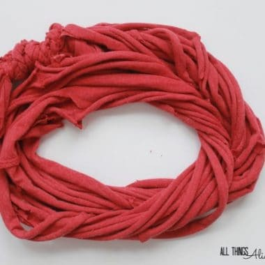 How to turn a T-Shirt into a scarf DIY T-Shirt scarf Red T-shirt cut into an infinity scarf
