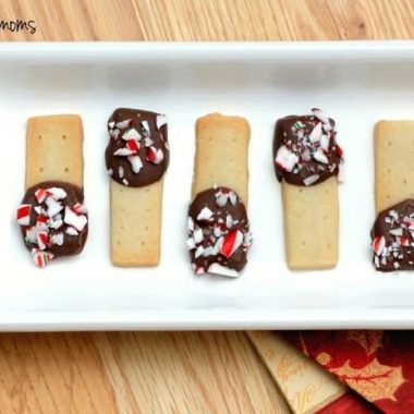 Holiday Chocolate Dipped Shortbread, shortbread dipped in chocolate topped with crushed candy cane served on a white serving dish