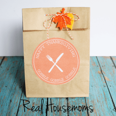 Thanksgiving Goodie Bag brown paper bag with orange circle logo festive fall string and leaves to seal