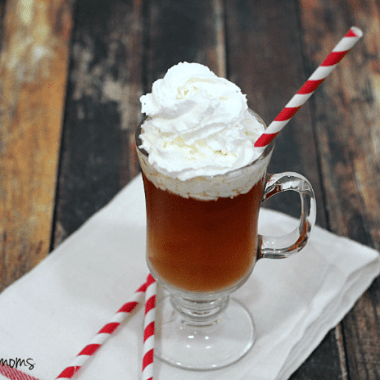 whipped hot toddy served in a glass topped with whip cream